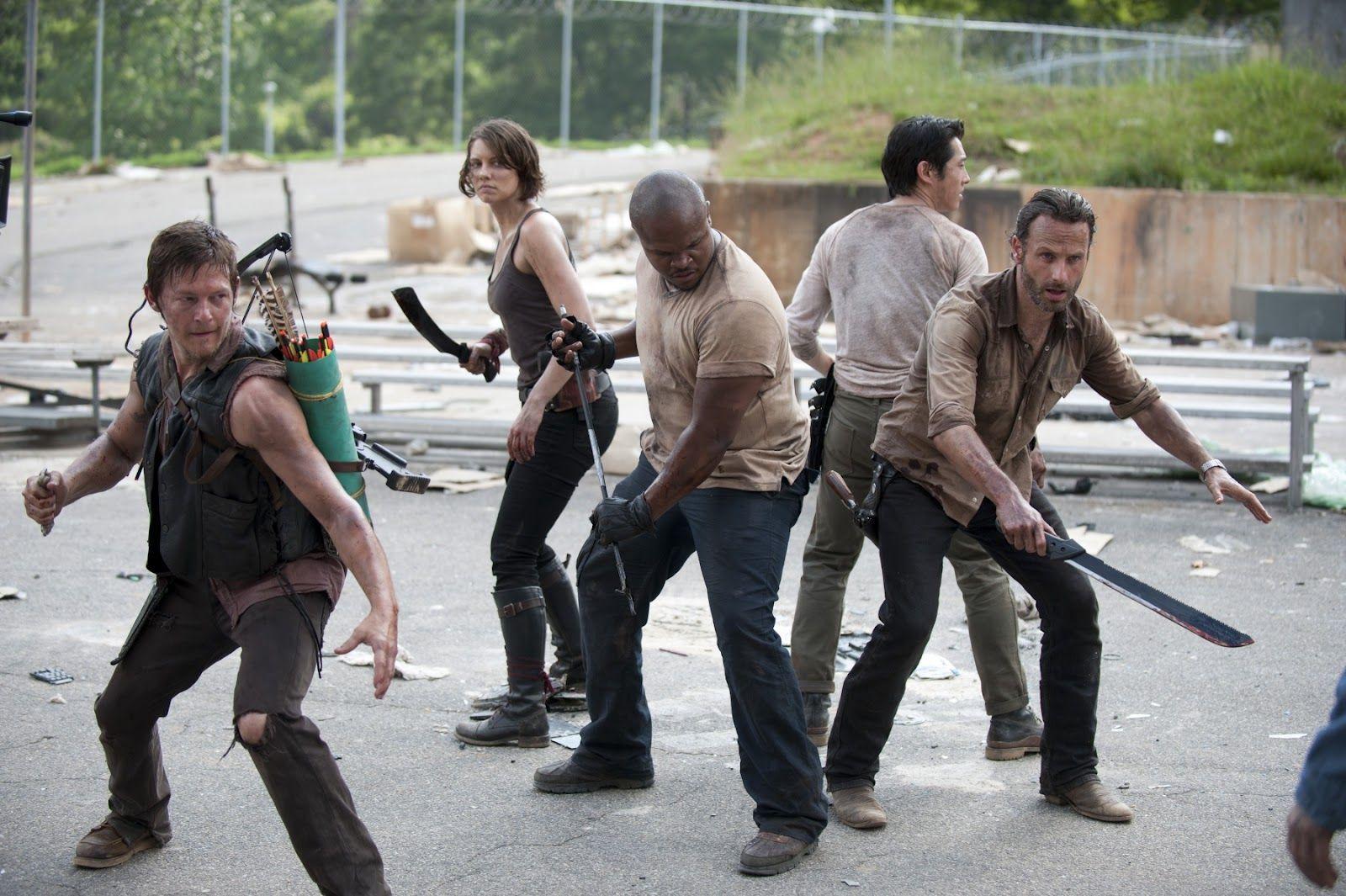 ¿Qué personaje se suicida en el comic dejandose comer por zombies pero sigue viv@ en la serie?