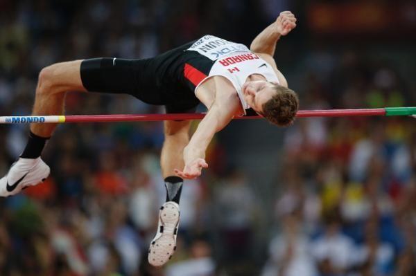 ¿ Cuál es el récord de salto de altura (masculino)?