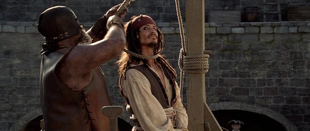 Tras abandonar a Jack con la Perla Negra, los piratas regresan a Port Royal el día de su ejecución. ¿Por qué?