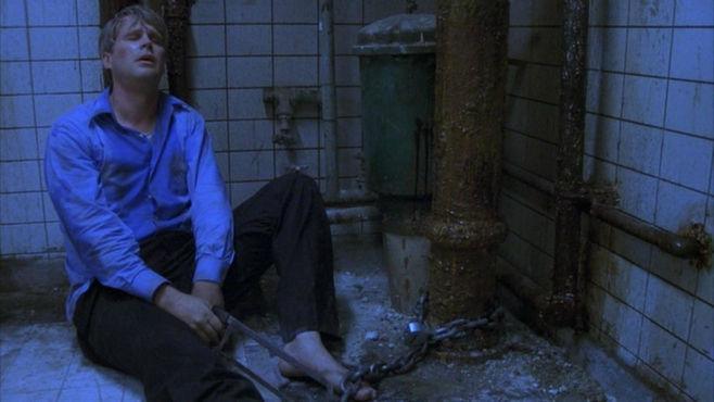 ¿Donde iban a estar atrapados originalmente Adam y Lawrence en la primera película de Saw?